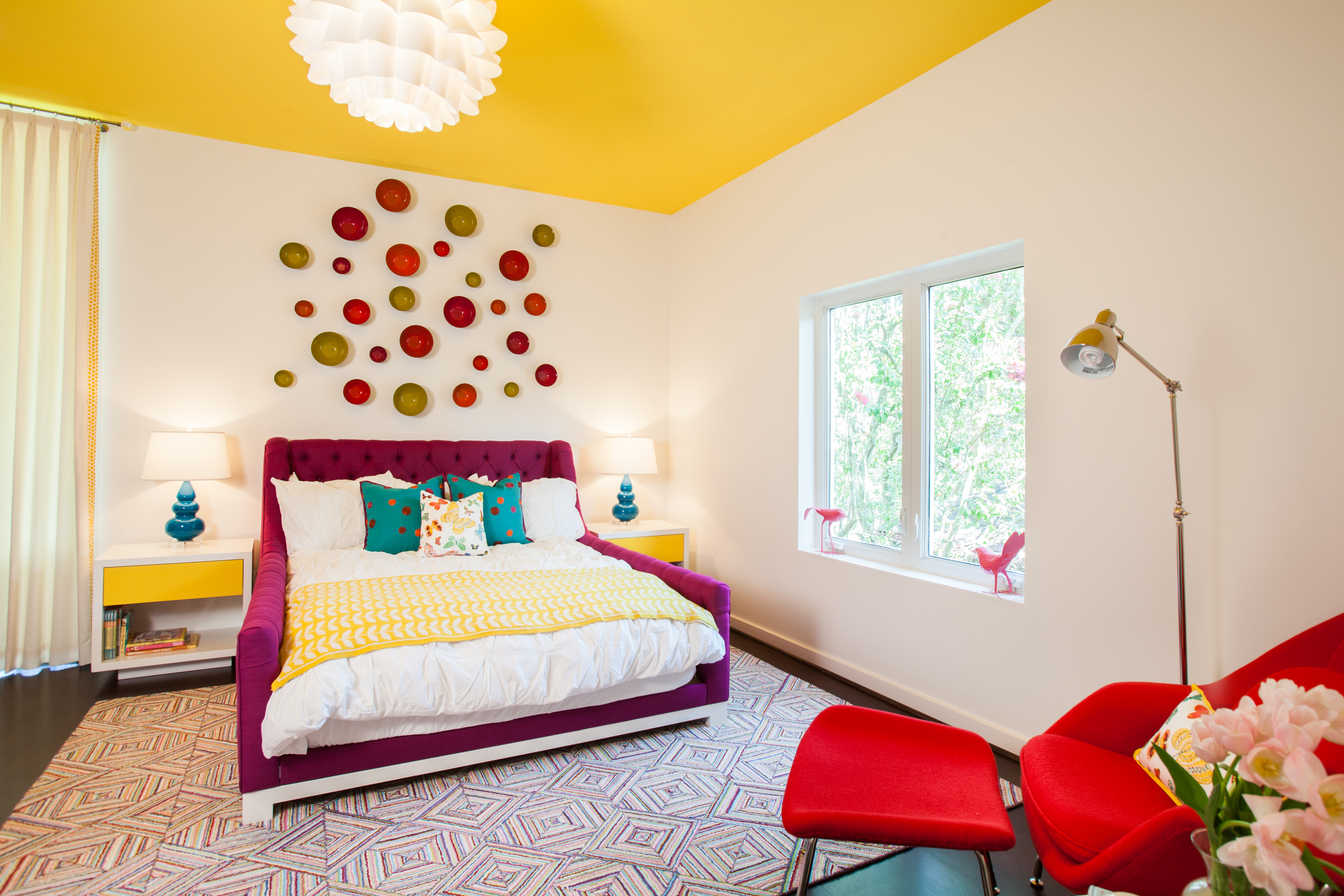 Colorful teen bedroom with bright yellow ceiling - Laura U Interior Design