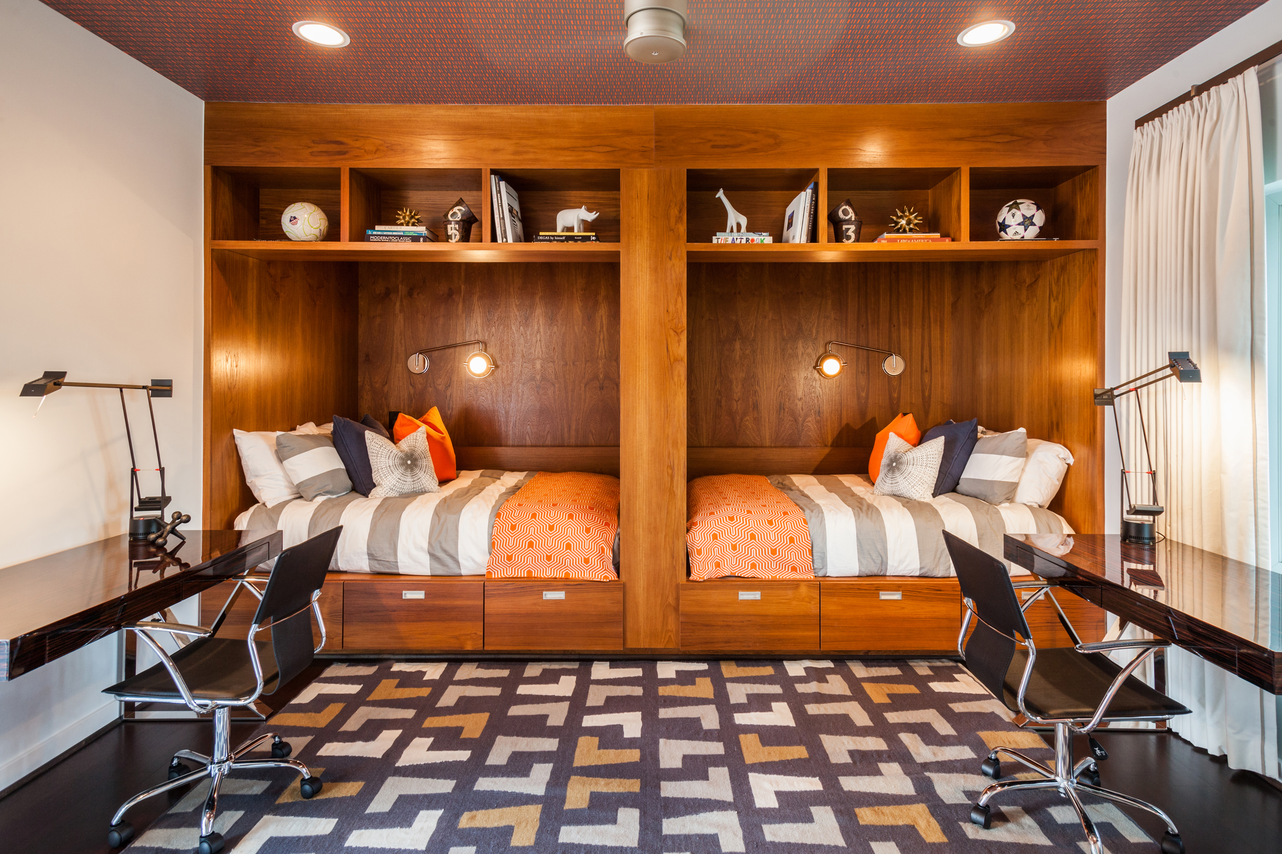 Twin orange and wooden day beds with modern desks - Laura U Interior Design