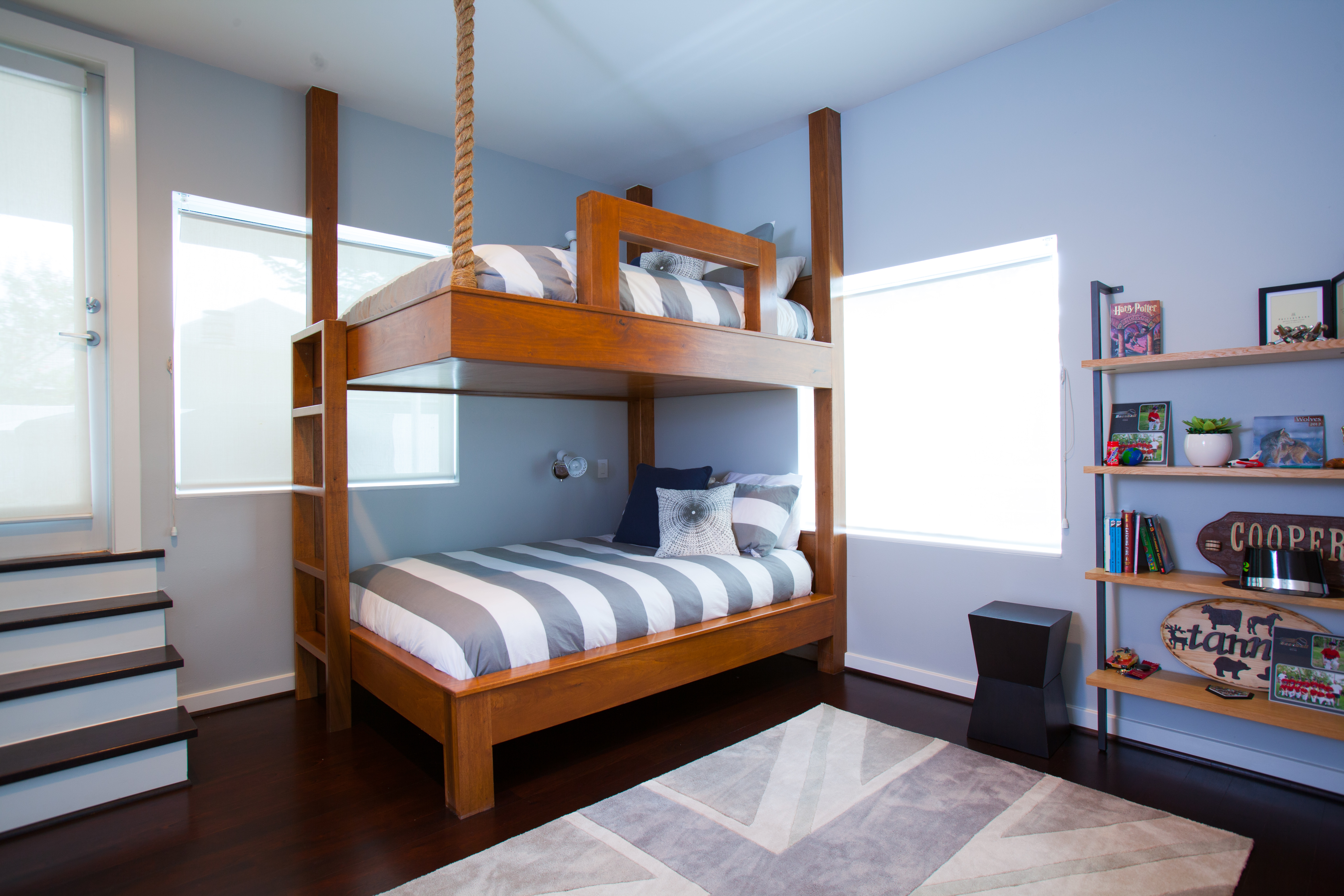Nautical striped blue wooden bunk beds in modern kids room - Laura U Interior Design