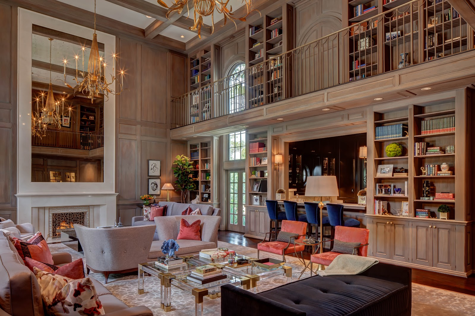 Grand paneled library with gold chandeliers - Laura U Interior Design