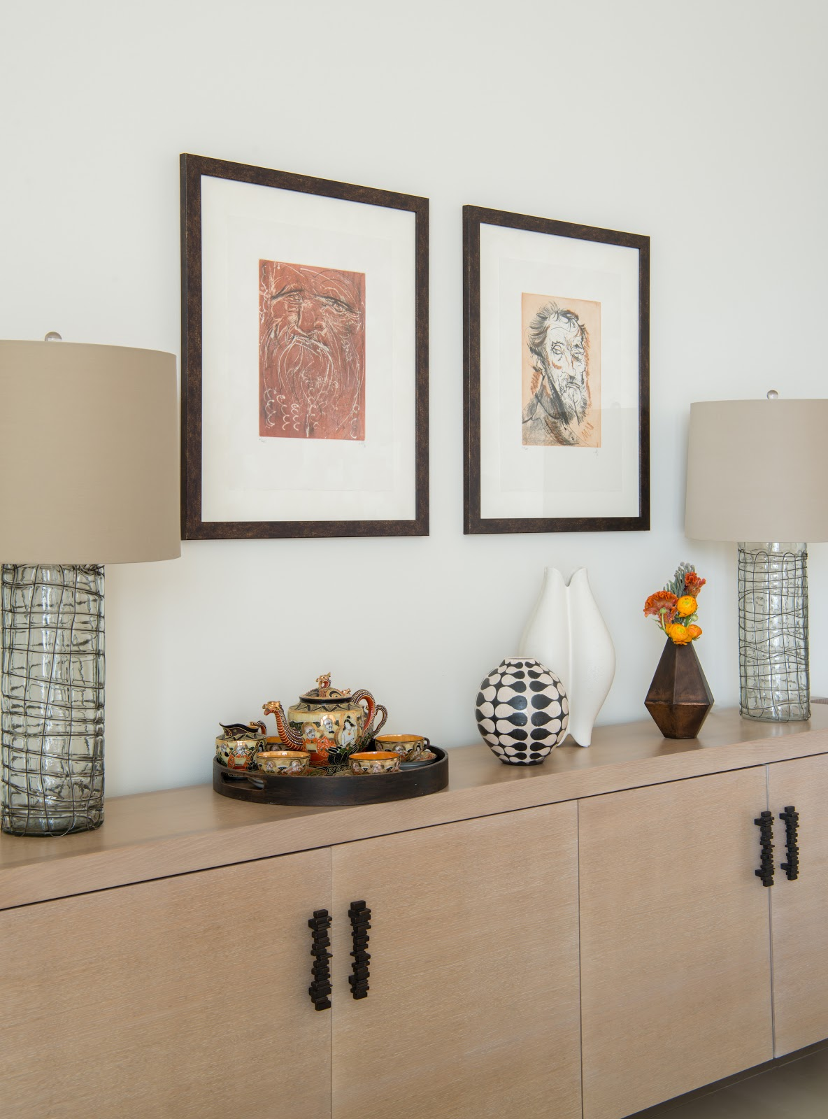 Collected high-rise with vintage tea set, industrial lamps, pottery and framed impressionist art - Laura U Interior Design