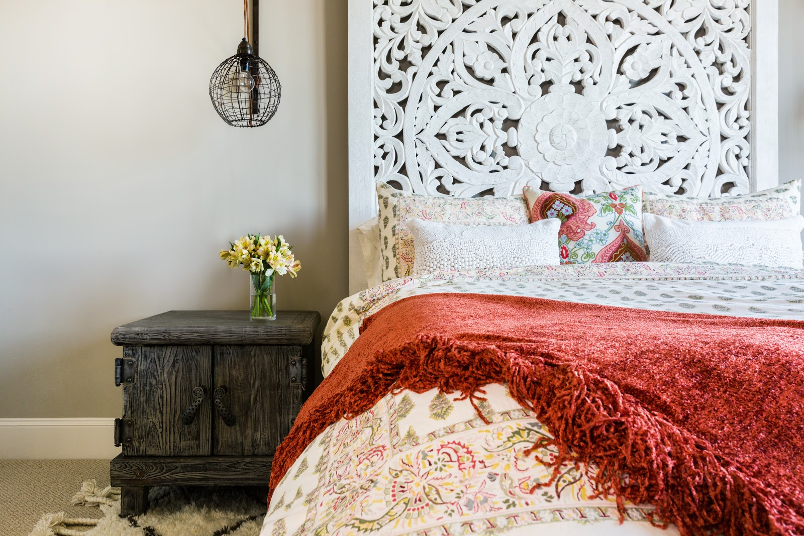 Intricate Anthropologie wooden headboard with India vibe - Laura U Interior Design