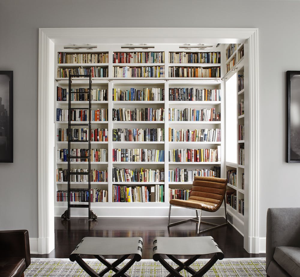 Antique ladder in modern home library from Dering Hall
