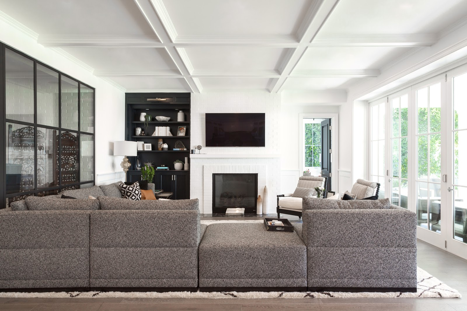 Clean-line, masculine living room with charcoal gray custom sofa - Ohorona24.in.ua Interior