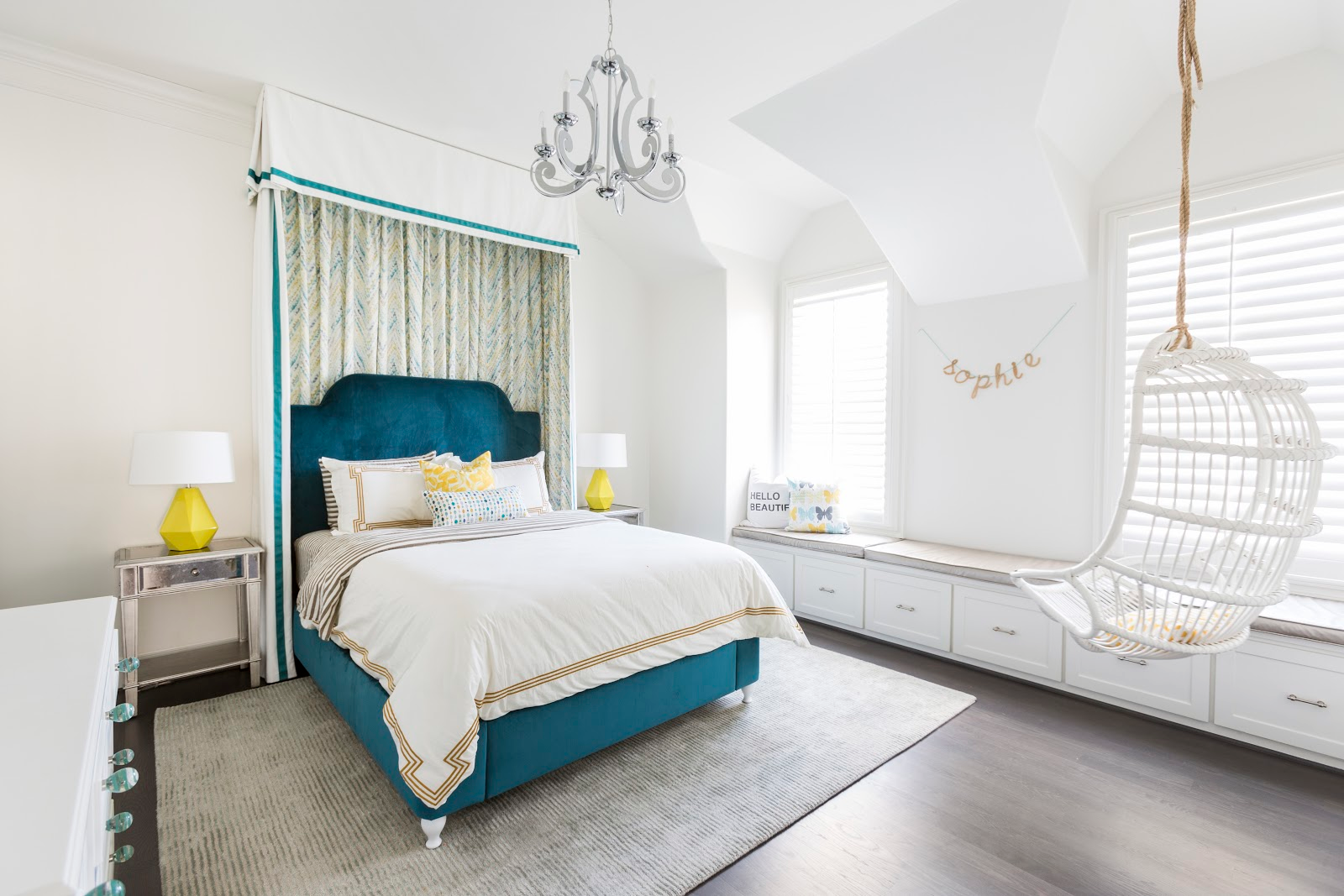 Teal velvet custom headboard in chic teenage bedroom with white hanging chair - laura u interior design