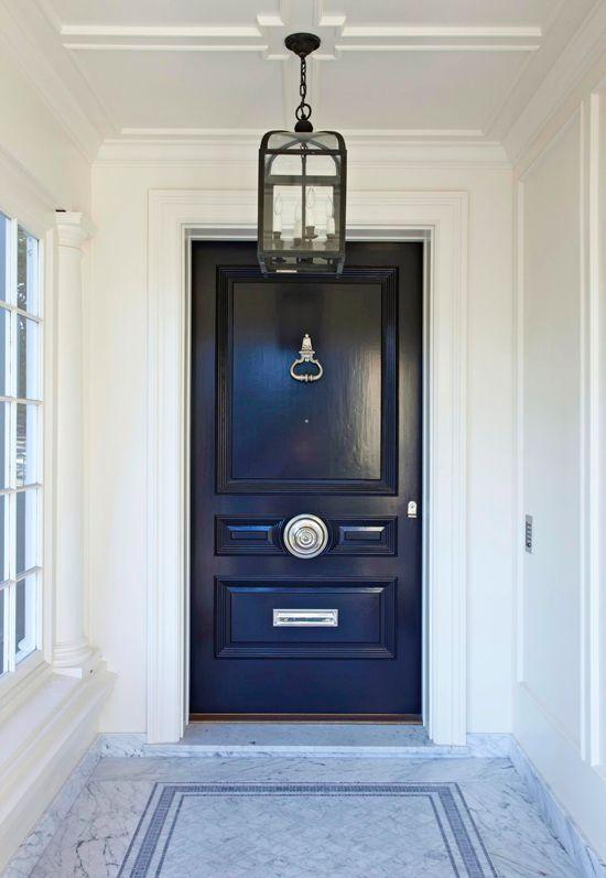 Selecting your front door. Dark navy traditional front door, marble flooring