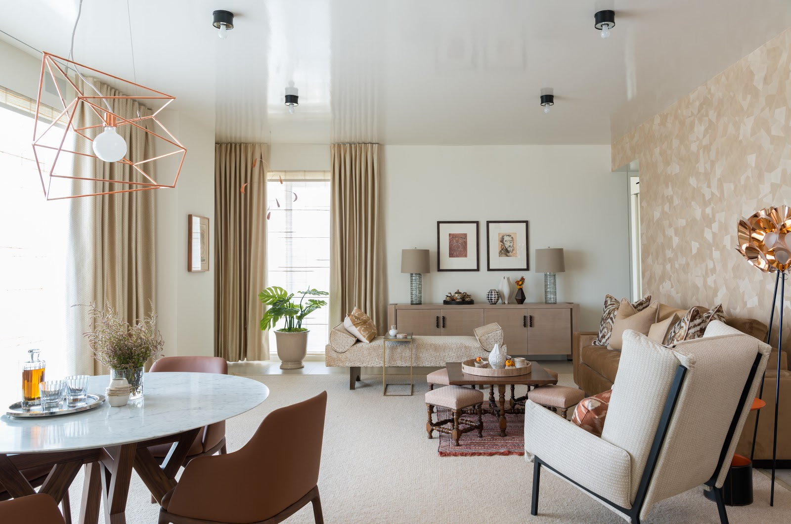collected high-rise minimalist living room with copper geometric lighting and neutral colors - laura u interior design