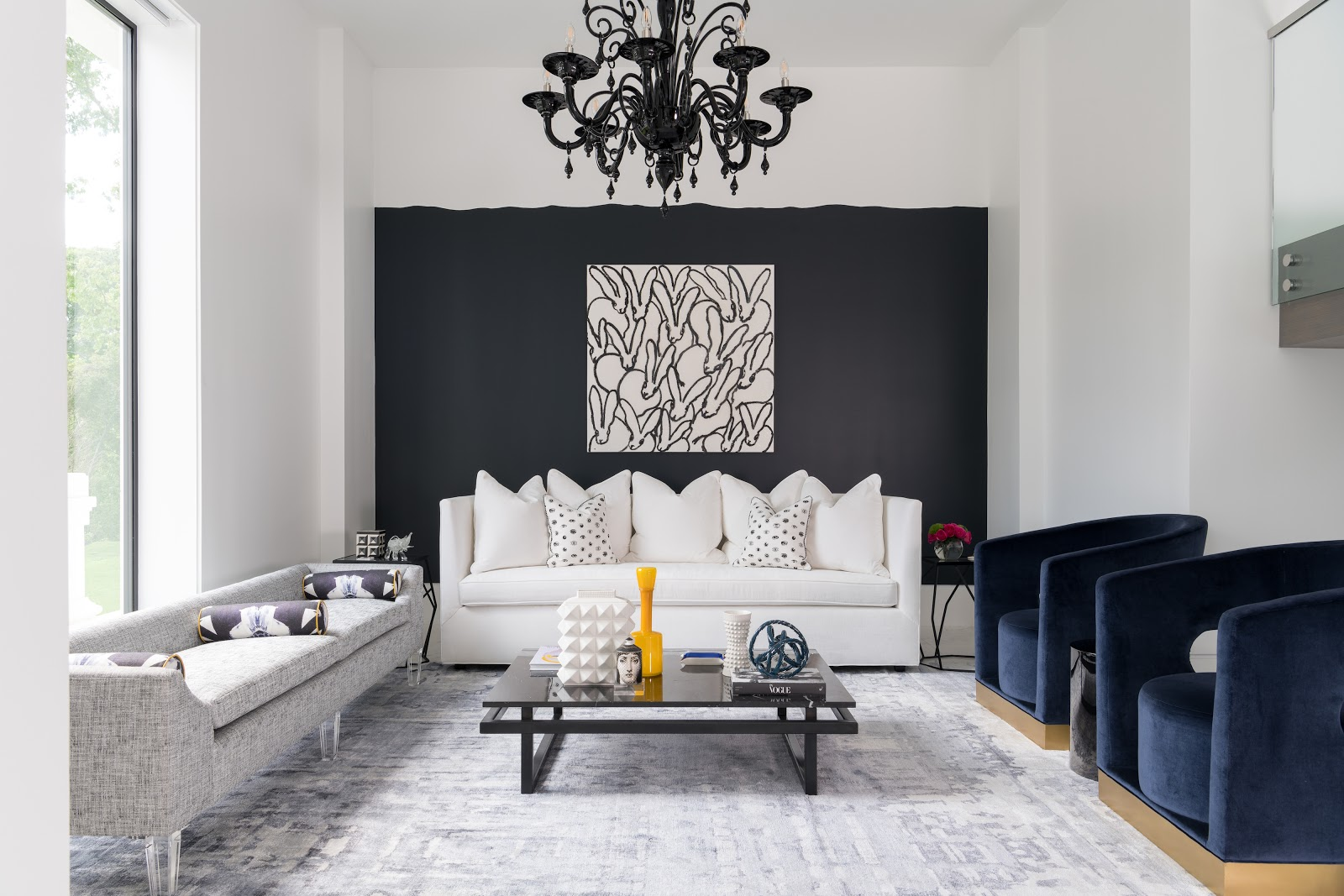 Modern minimal sitting area with Hunt Slonem black and white glitter bunnies - Laura U Interior Design