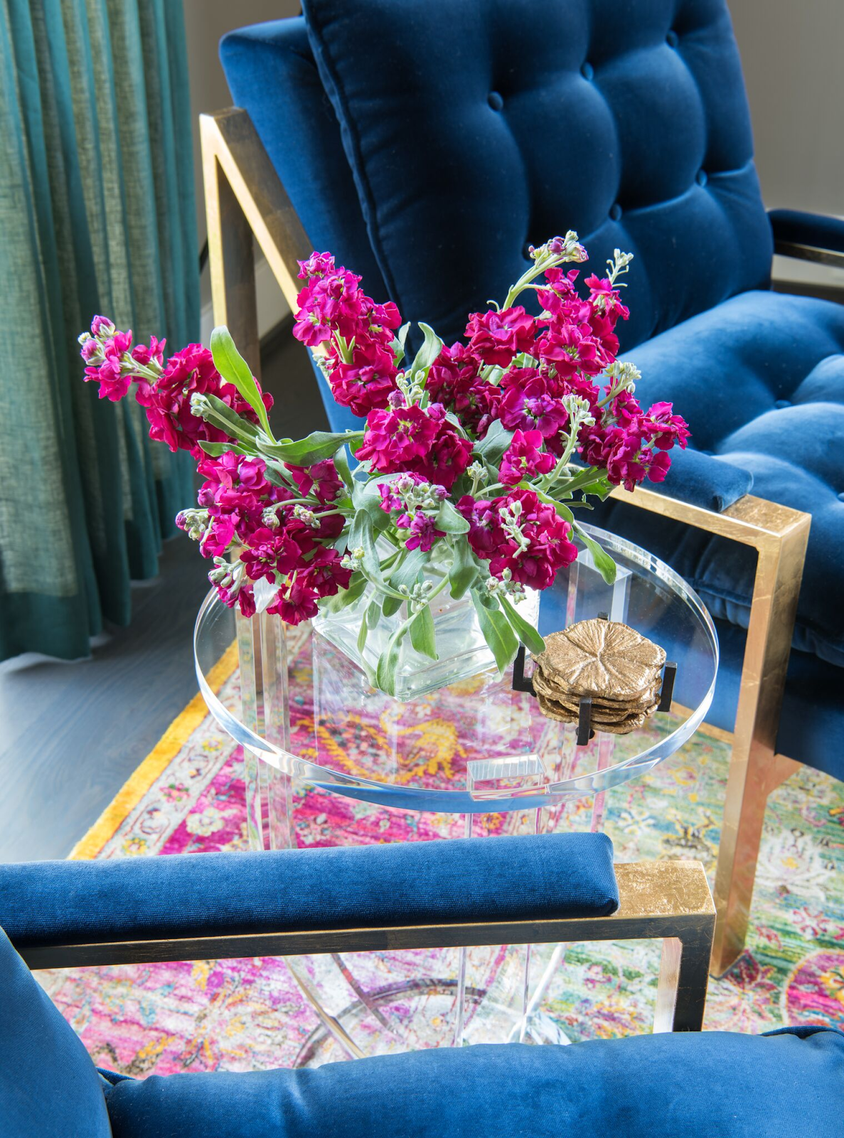 Cobalt blue tufted chair with florals on martini table by Laura U Interior Design