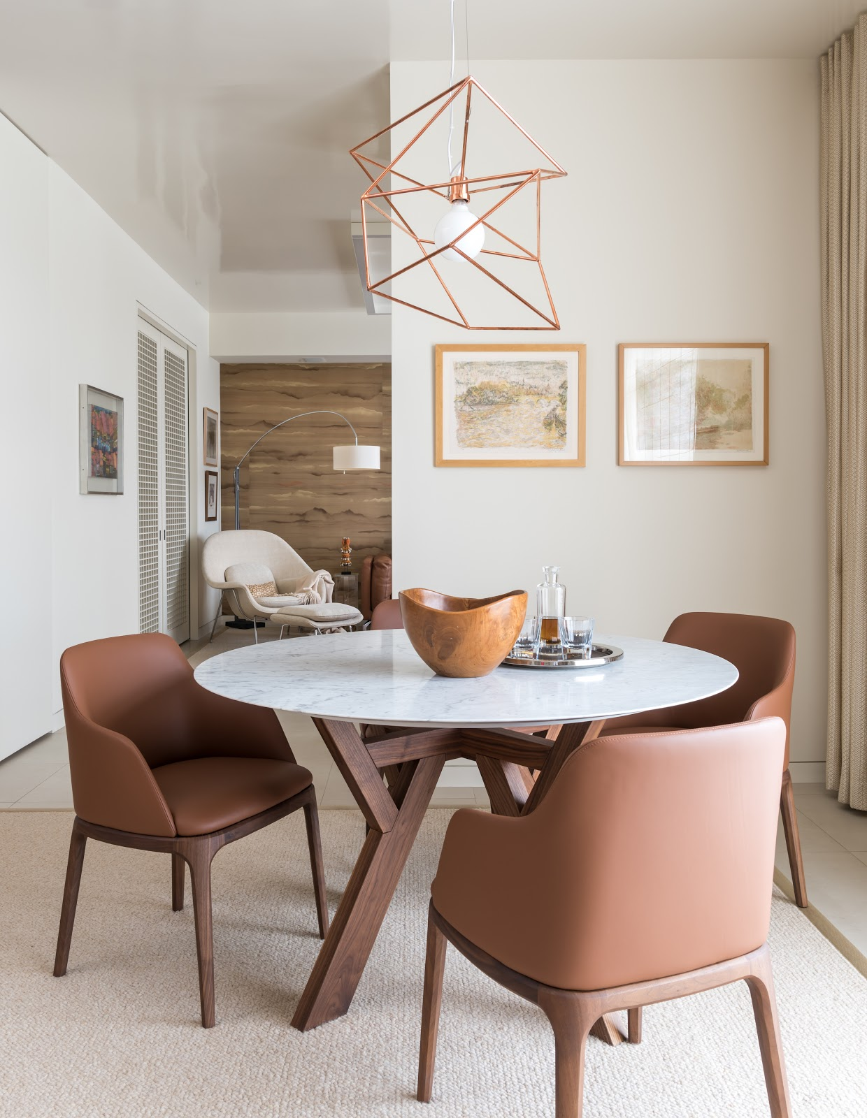 earthy collected high-rise breakfast nook with copper metallic geometric lighting - laura u interior design