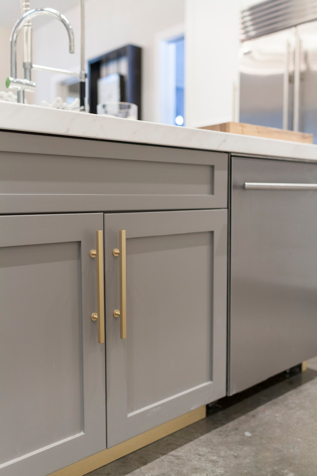 Gray and gold modern kitchen cabinets by Laura U Interior Design