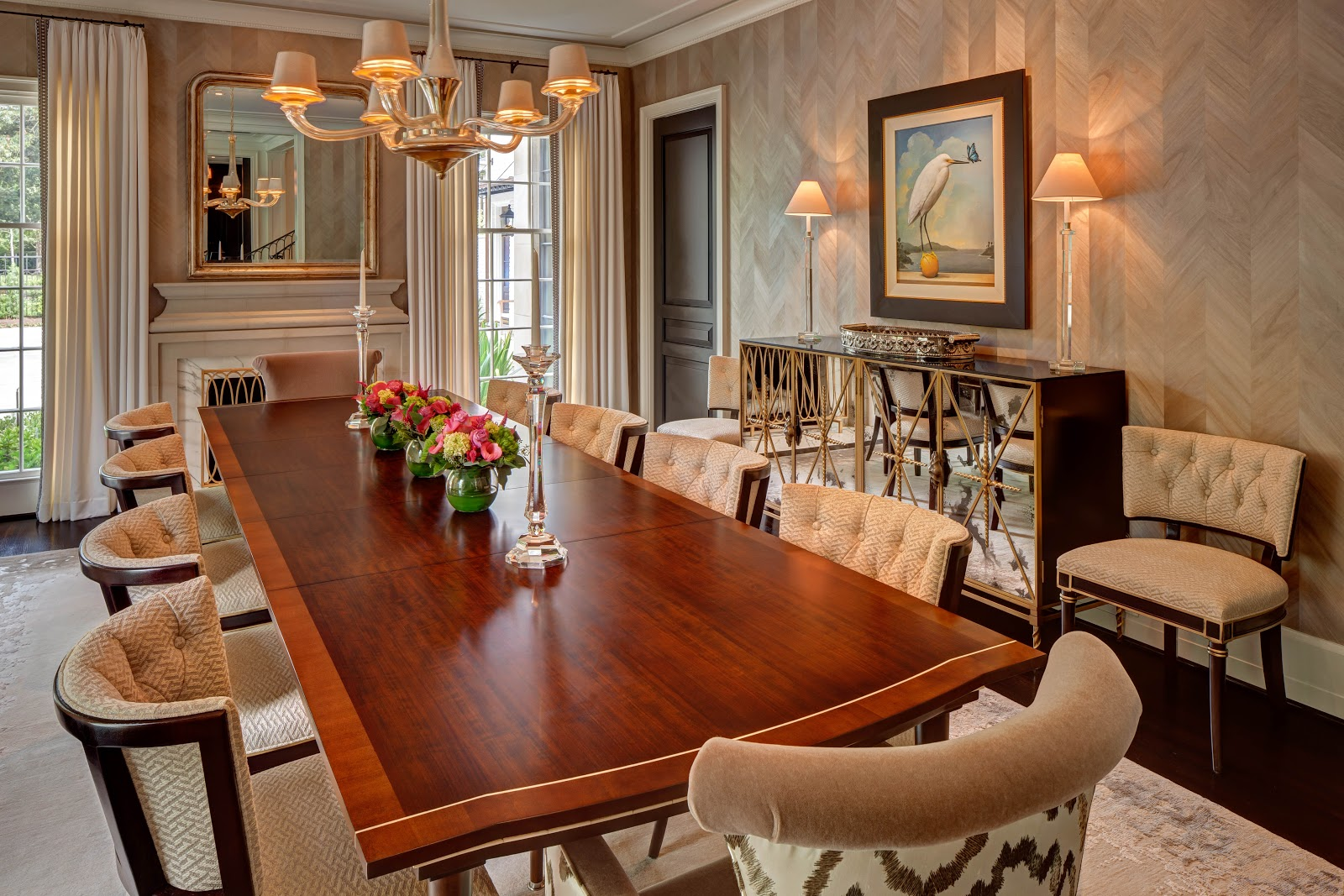 Formal dining room with marble fireplace surround - Laura U Interior Design