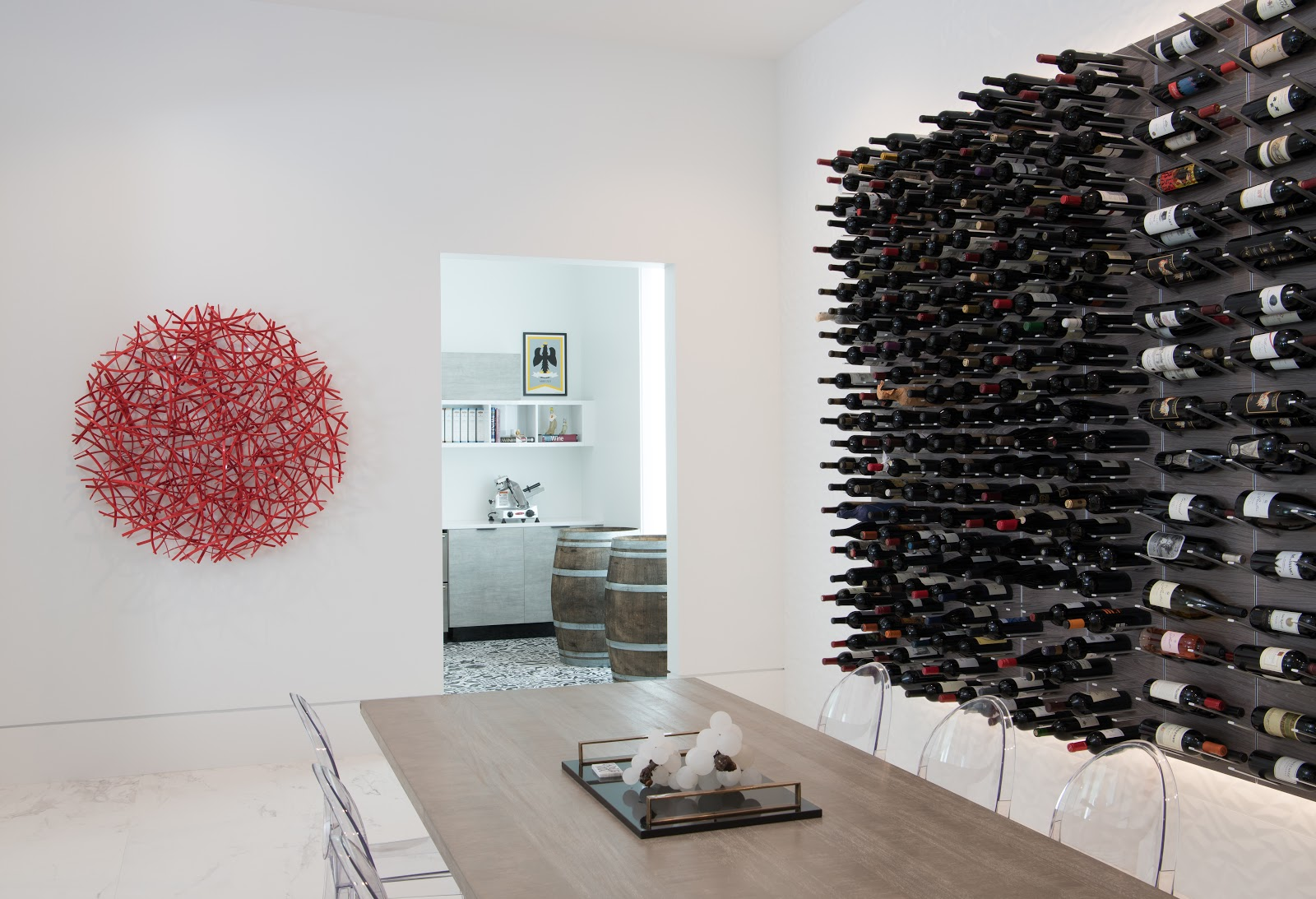Custom wine cellar wall with vibrant modern art - Laura U Interior Design
