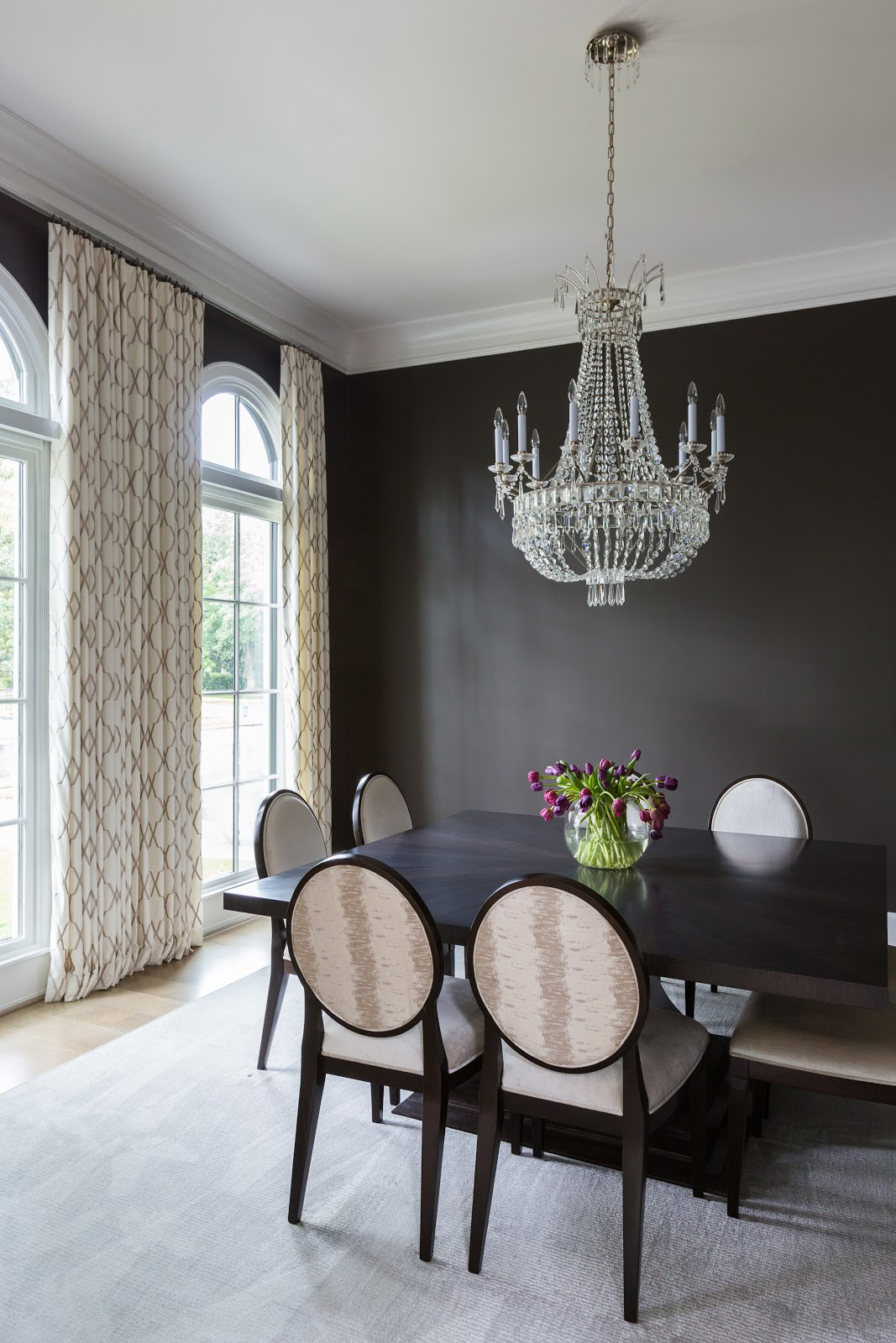 Traditional antique crystal chandelier in dark dining room - Laura U Interior Design