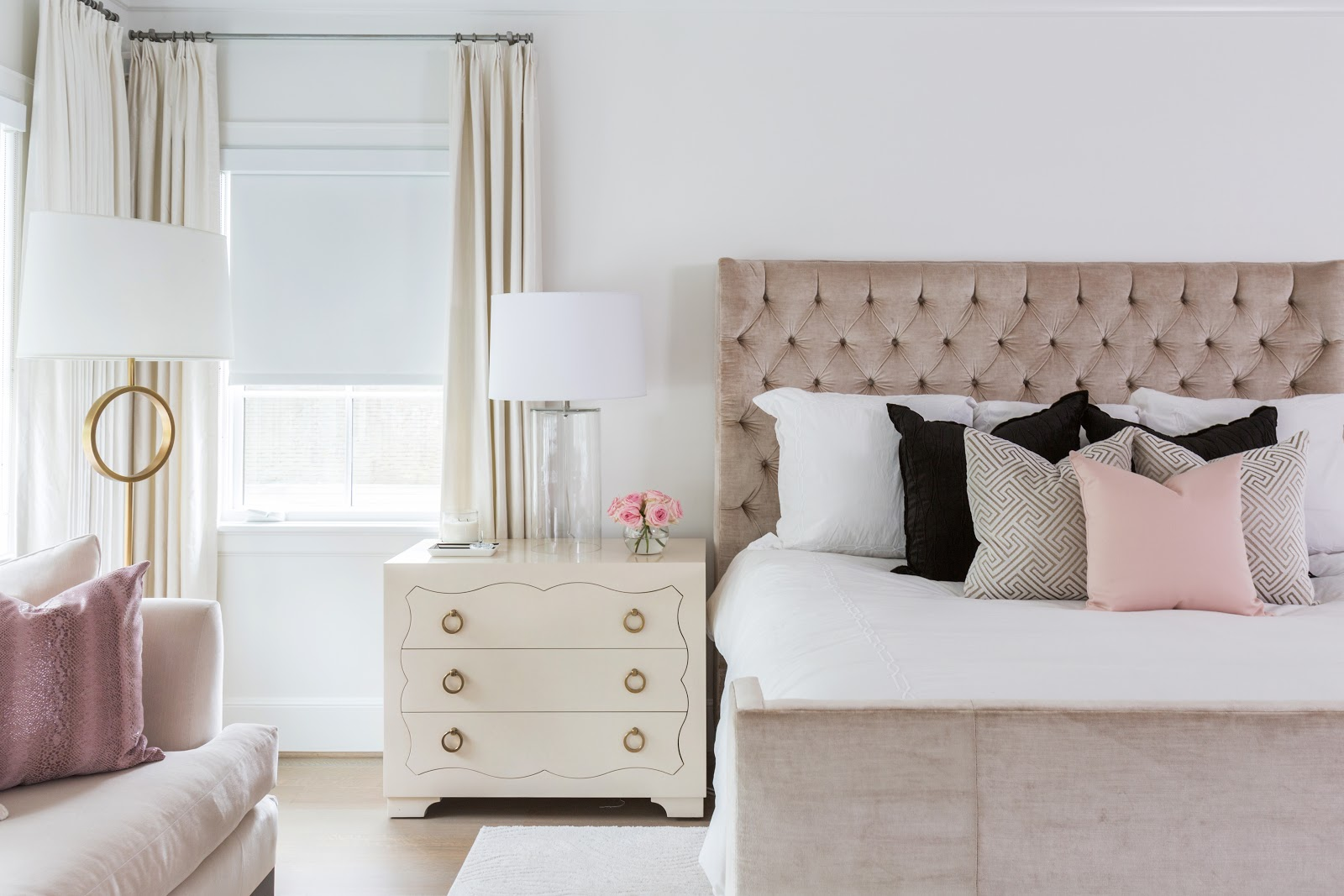 Blush velvet tufted headboard with neutral bedding and side table - laura u interior design