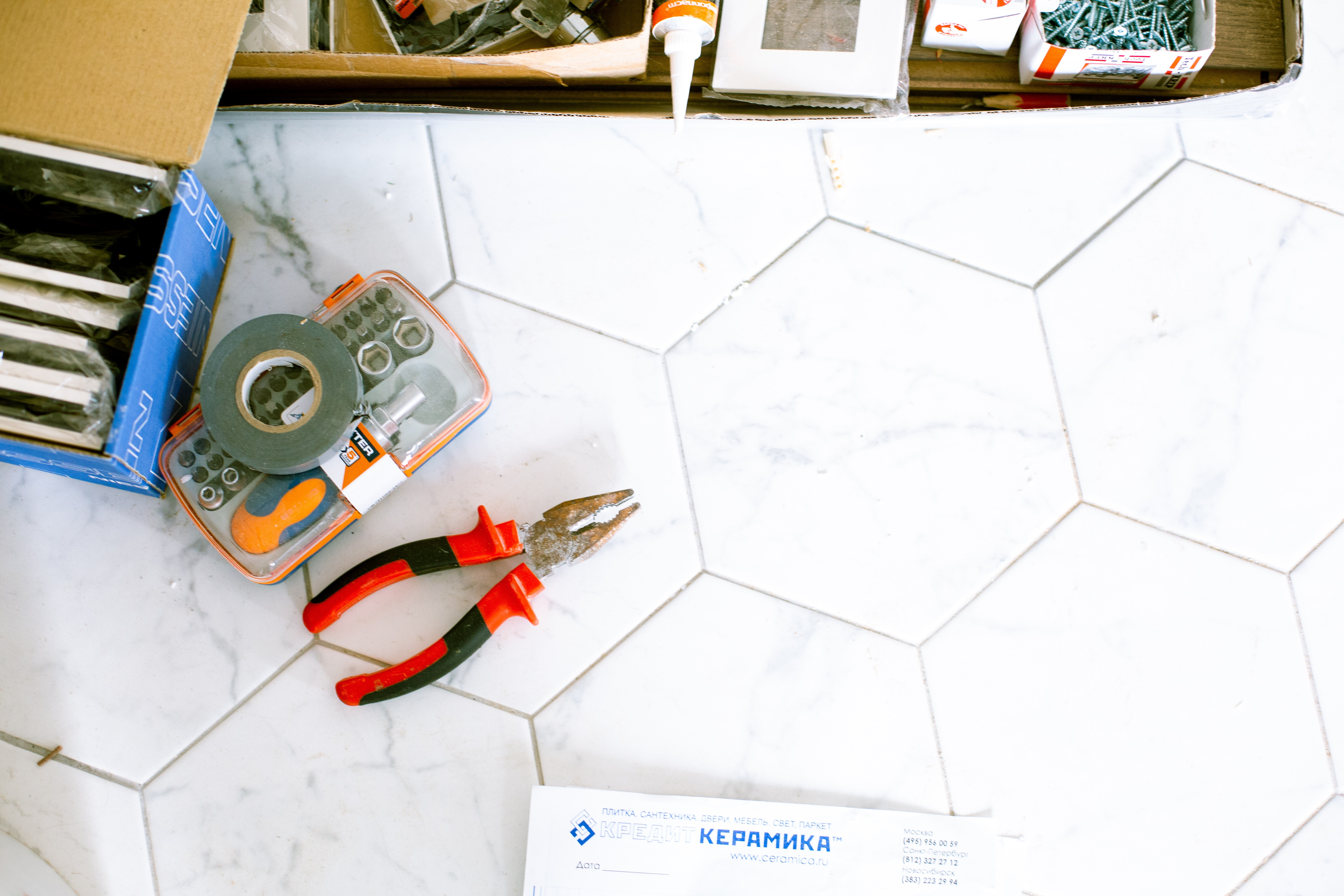 Tools laying on tile for home care and repair