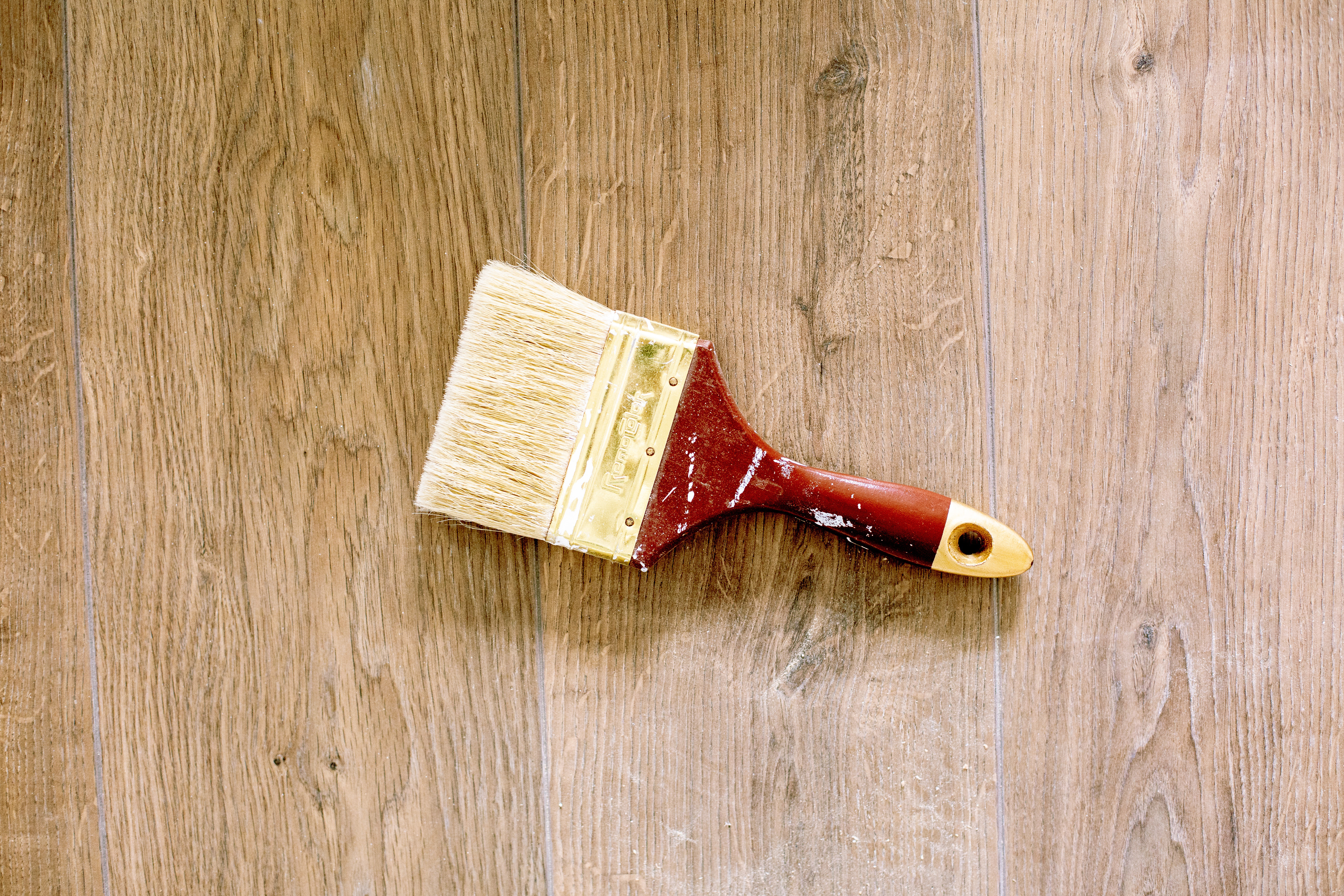 Paint brush on wood for home care and repair