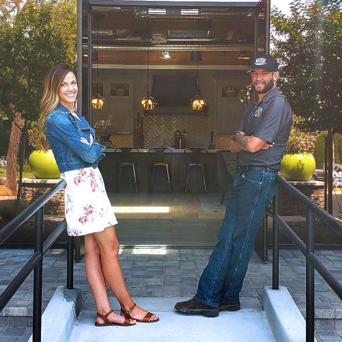 JRP Family Business Emily and Grant outside the office entrance