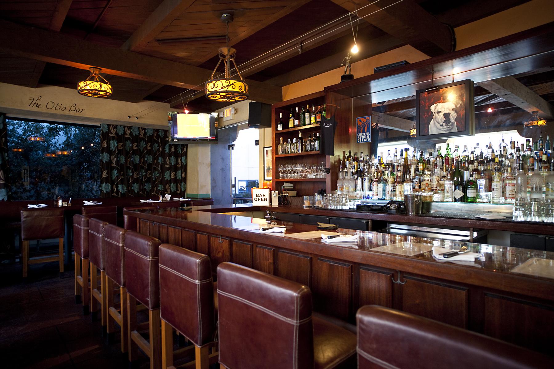 The bar and stools at The Otis Bar
