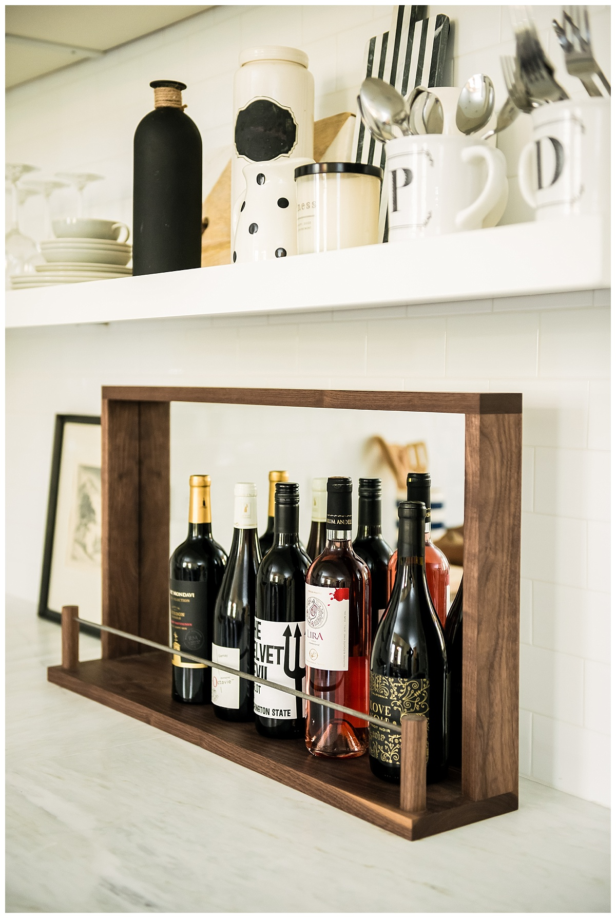 'The Top-Shelf,' our mirrored, walnut + steel shelf, specifically designed to showcase your favorite wine and spirits. Walnut, our most sought-after wood, is known for its long-lasting durability, as well as its rich, beautiful tones, grains, and figure. Treat yourself, or purchase as a thoughtful gift for the cocktail connoisseur or the sentimental minimalist in your life. | Lemiga Events | Host + Toast