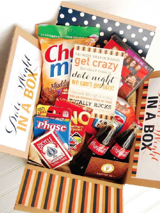 Date Night in a Box with candy, games, and soda in the box